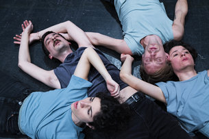 Group of dancers lying on the ground